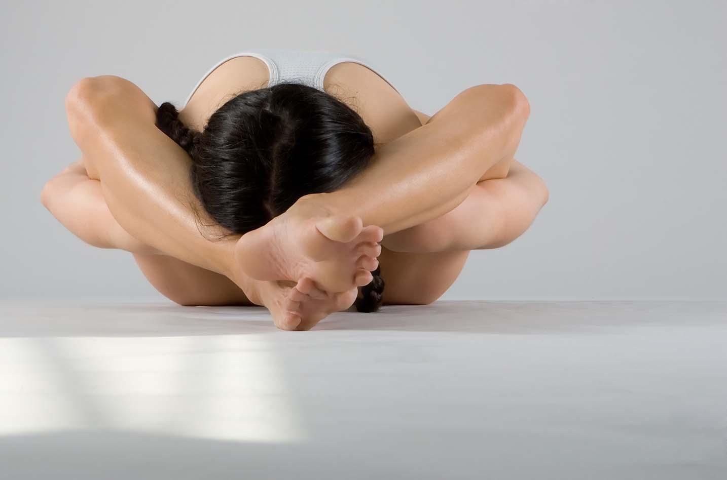 Female Olympia Legs Behind Head 3